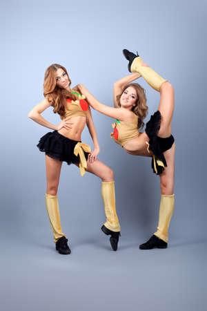 Two professional cheerleaders posing at studio.  photo