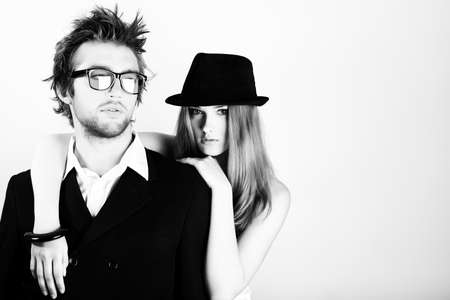 Shot of a fashionable young people posing in studio. photo