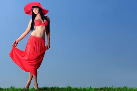 Beautiful young woman in bikini over blue sky. photo
