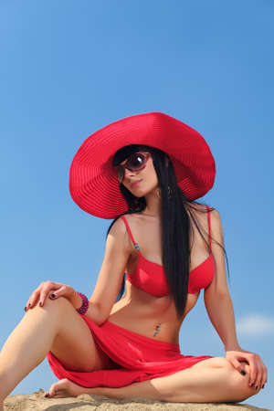 Beautiful young woman in bikini on a sunny beach. photo