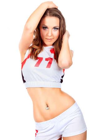 Beautiful girl cheerleader posing at studio. Isolated over white. photo