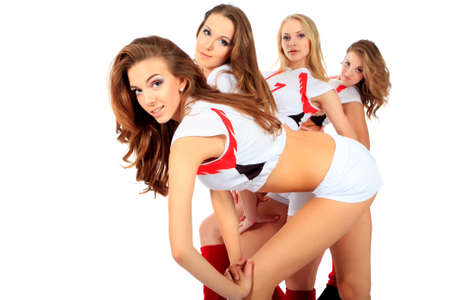 squad: Group of professional cheerleaders posing at studio. Isolated over white.