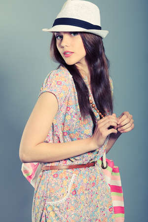 glamur: Shot of a beautiful girl in summer style posing at studio.