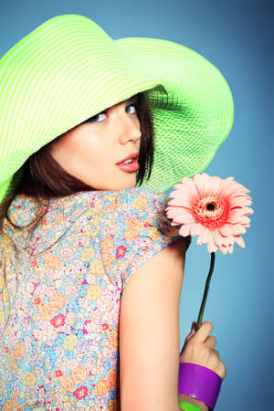 spring hat: Shot of a beautiful girl in summer style posing at studio.