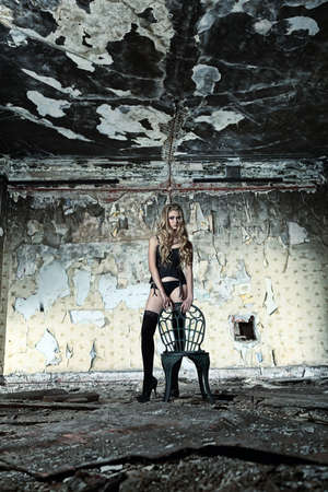 Beautiful lonely woman in the old house. photo