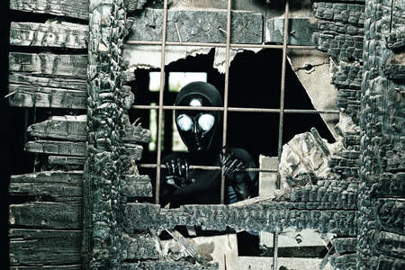 Scary alien creature in an abandoned house. Halloween, horror. photo