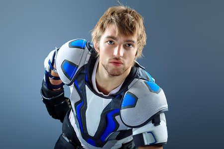 Portrait of a handsome ice-hockey player. Studio shot. Stock Photo - 14322477