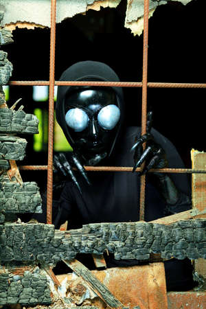 Scary alien creature in an abandoned house. Halloween, horror. Stock Photo - 14342904