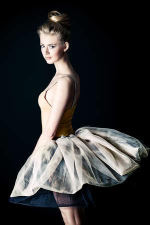 Beautiful ballet dancer posing at studio. Stock Photo
