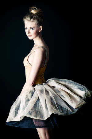 ballet studio: Beautiful ballet dancer posing at studio. Stock Photo