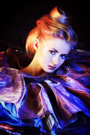 Art fashion photo of a beautiful model. Over black background. Stock Photo - 14342859