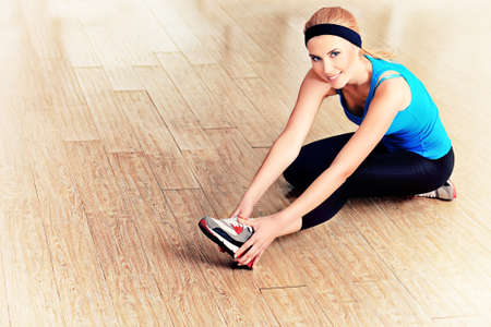 fitness center: Young sporty woman doing exercises in the gym centre. Stock Photo