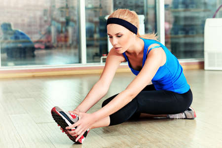 Young sporty woman doing exercises in the gym centre. photo
