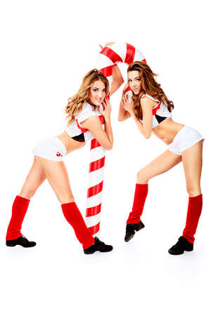Two professional cheerleaders posing at studio. Isolated over white. photo