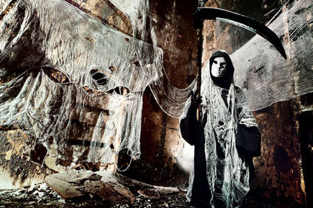 Frightening death in an abandoned house. Halloween, horror. photo