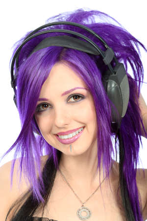 Portrait of a punk girl in headphones. Isolated over white background. photo