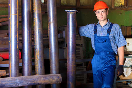 Industry: a worker at a manufacturing area. photo
