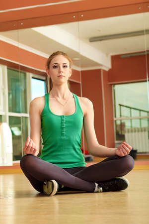 Young women in the gym centre. Yoga class. Stock Photo - 14428957