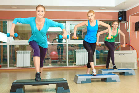 Group of young women in the gym centre. Pilates class. photo