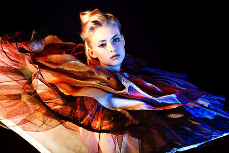 performance art: Art fashion photo of a beautiful model. Over black background.