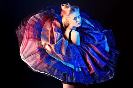 Art fashion photo of a beautiful model. Over black background. Stock Photo - 14473922