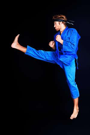 tae: Martial arts fighter posing at studio.