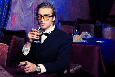 Portrait of a handsome groom on his wedding celebration. photo