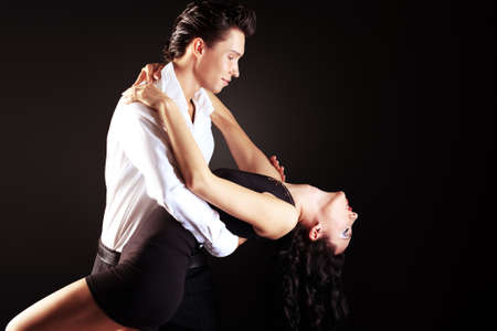 salsa dancing: Beautiful couple of professional artists dancing passionate dance. Stock Photo