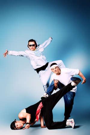 Group of modern dancers dancing hip-hop at studio. Stock Photo - 14551452