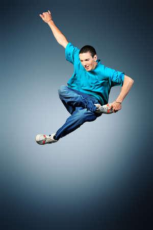 break dance: Trendy young man dancing hip-hop at studio.