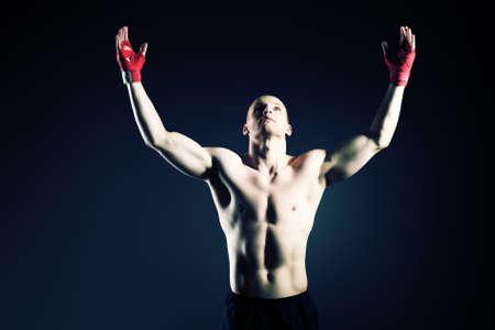 male boxer: Portrait of a boxer champion enjoying his victory. Studio shot.