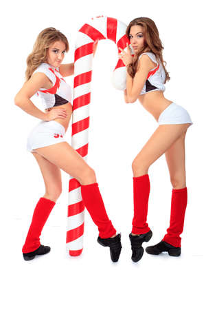 sexy girl dance: Two professional cheerleaders posing at studio. Isolated over white. Stock Photo