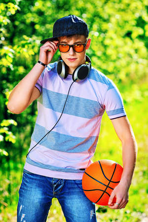 boy basketball: Portrait of a young man student outdoors.