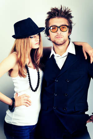 men hair style: Shot of a fashionable couple posing at studio.