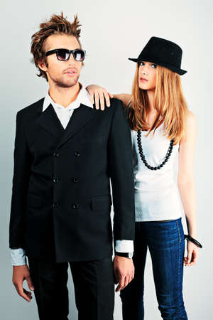 Shot of a fashionable couple posing at studio. photo