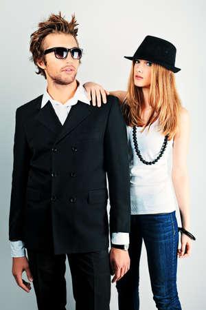 Shot of a fashionable couple posing at studio. photo