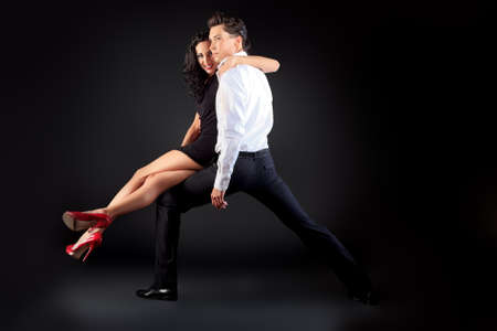 Beautiful couple of professional artists dancing passionate dance. Stock Photo - 14609519