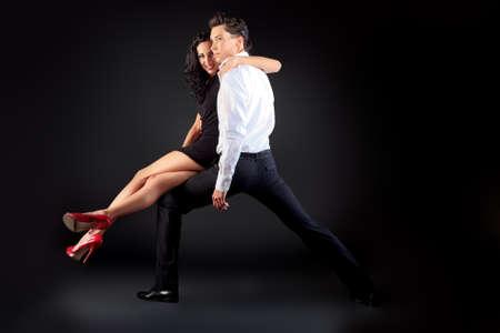 Beautiful couple of professional artists dancing passionate dance. Stock Photo - 14609519