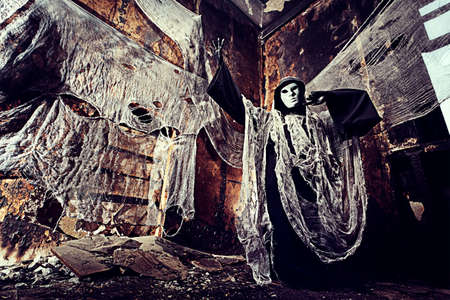 Frightening death in an abandoned house. Halloween, horror.