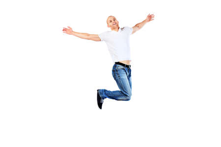 young man jeans: Portrait of a happy jumping man. Isolated over white.