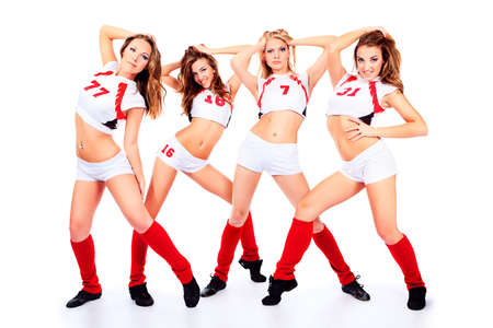 Group of professional cheerleaders posing at studio. Isolated over white. photo