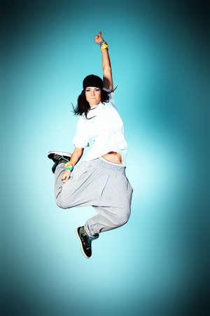 Modern girl dancing hip-hop at studio. Stock Photo - 14679998