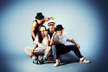 modern generation: Group of modern dancers dancing hip-hop at studio. Stock Photo