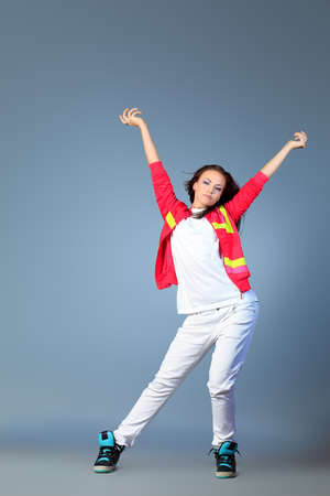 Modern girl dancing hip-hop at studio. photo