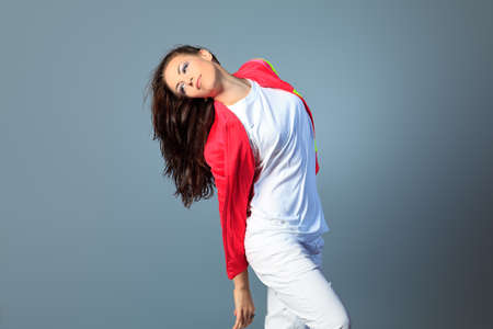 Modern girl dancing hip-hop at studio. Stock Photo - 14693690