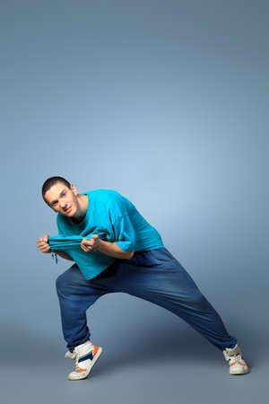 Trendy young man dancing hip-hop at studio. Stock Photo - 14693701