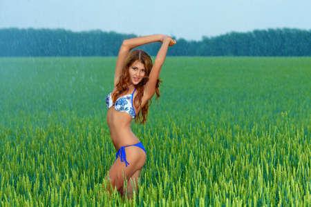 Shot of a sexy woman in bikini posing outdoor. Stock Photo - 14693713