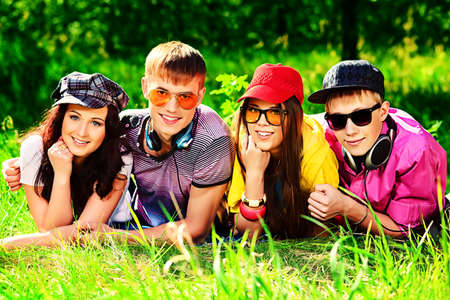 Group of young people having a rest together outdoors. photo
