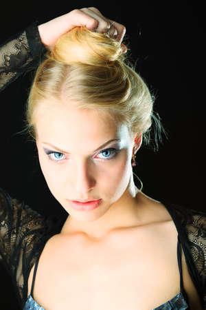 seductive women: Portrait of a beautiful blonde woman. Studio shot over black background.