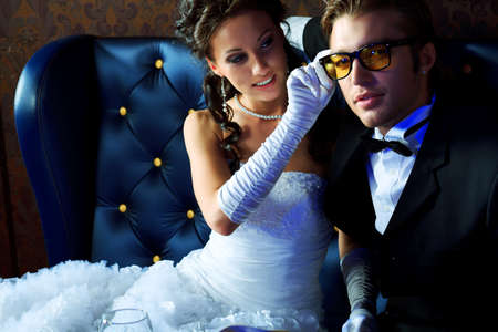 happy rich woman: Charming bride and groom on their wedding celebration in a luxurious restaurant. Stock Photo